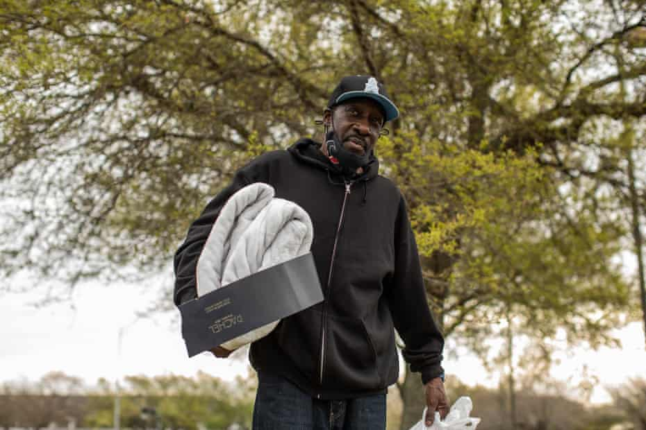 """Michael Birden picks up food at West Houston Assistance Ministries. """"Of course I go to bed hungry,"""" he said. """"I only have what they give me here."""""""