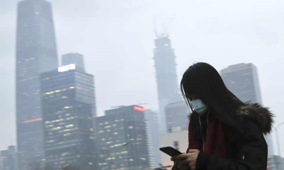 Woman wearing a mask.