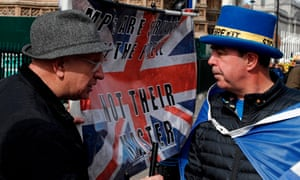 Anti-Brexit campaigner Steve Bray speaking to a pro-Brexit supporter outside the Houses of Parliament today.