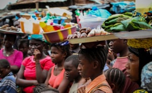 Women at the Congo market in Freetown stand and listen to outreach workers from the Aberdeen Women's Centre, who are performing a skit on family planning, early marriage and fistula (a hole in the birth canal linked to obstructed labour, which leaves women with chronic incontinence)