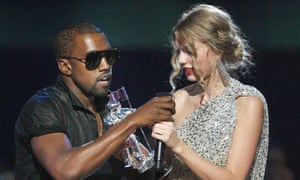 Kanye West takes the microphone from singer Taylor Swift as she accepts an award at the MTV Video Music awards in New York City on 13 September 2009.