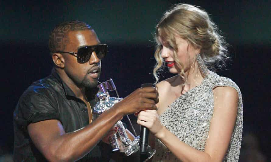 Kanye West takes the microphone from Taylor Swift during the MTV Video Music awards, 13 September 2009.