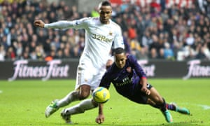 Kyle Bartley, left, then playing for Swansea, tussles with Arsenal's Theo Walcott in a 2013 FA Cup tie. Bartley made one appearance for Arsenal in 2009.