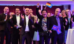 Supporters of AfD react to exit poll results at an election night event in Erfurt, eastern Germany