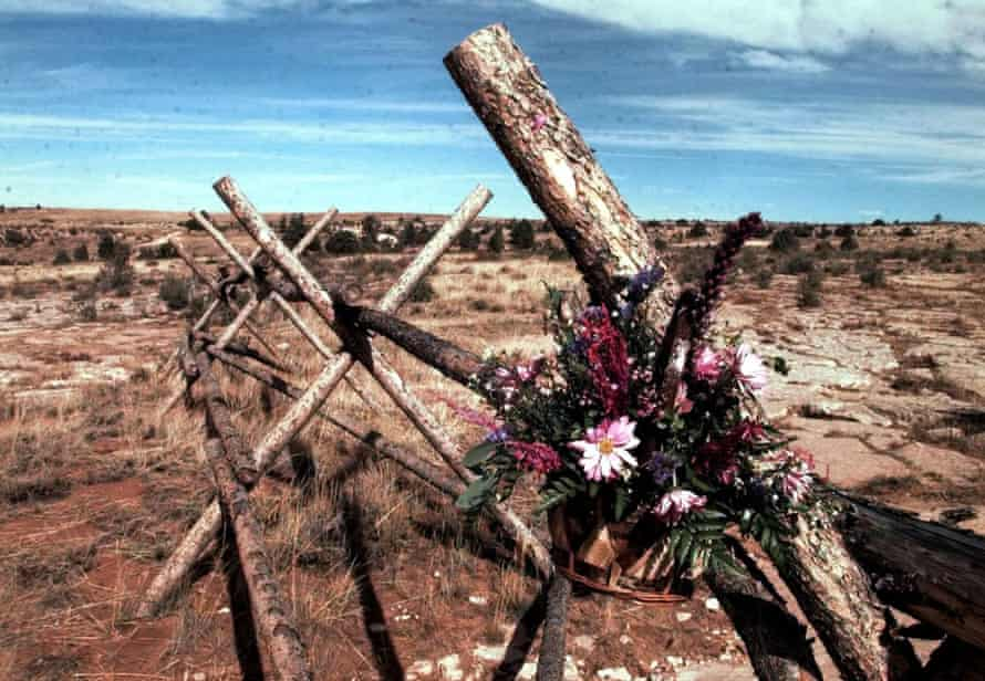 A tribute to Matthew Shepard hangs from the fence where he was tied and beaten near Laramie, Wyoming.