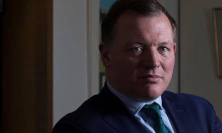 portrait of Tory mp Damian Collins in his office