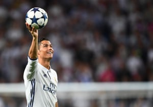 Ronaldo celebrates his hat trick with the match ball at full time.