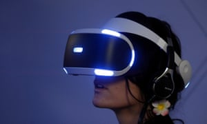 A gamer plays a game with the virtual reality head-mounted display 'Playstation VR'.