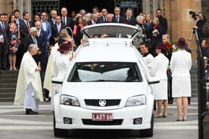 The casket is carried out of St Patrick's Cathedral in Melbourne on Tuesday.