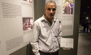 A member of the museum's staff displays one of Yasser Arafat's notebooks