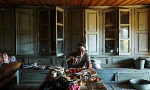 Tusheti, Georgia: a man eats in his kitchen