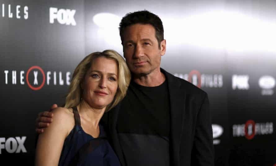 Cast members Gillian Anderson and David Duchovny pose at a premiere for The X-Files at California Science Center in Los Angeles.