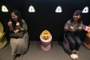 Music plays as users pretend to poo