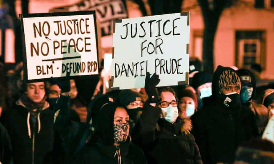 People march in protest after the New York grand jury voted not to indict police officers in Daniel Prude's death.
