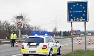 Danish police officers check vehicles at the border with Germany.