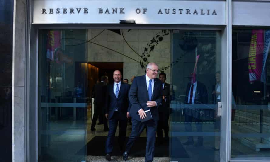 Josh Frydenberg and Scott Morrison leave the Reserve Bank building