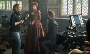 Director Josie Rourke and actors Margot Robbie and Joe Alwyn on the set of Mary Queen of Scots.