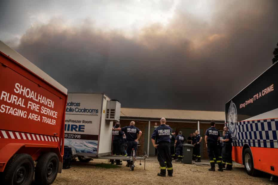 The southerly wind hits the rugby club which is the staging area for emergency services for Nowra, and the sky turns black on Saturday.