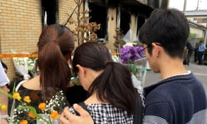Mourners visit the Kyoto Animation building. The suspect was seen visiting sites made famous by anime in the lead up to the attack in which 35 people died.