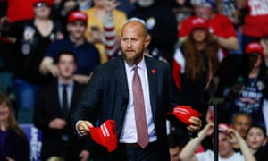 Brad Parscale, Trump's throws Make America Great Again hats to the audience before a rally in Michigan last year.