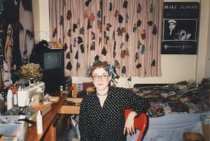"""""""I must have been curling my hair that day!"""" Sarah Trivuncic at her university halls of residence in the early 90s with a Mother Fist poster on the wall behind"""