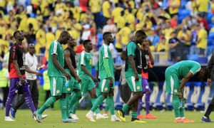 Senegal players troop off the field after the 1-0 defeat by Colombia ended their World Cup campaign.