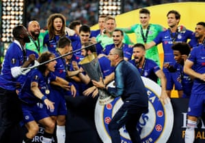 Chelsea manager Maurizio Sarri celebrates winning the Europa League with the trophy and his players.