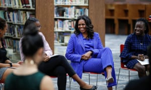 Former first lady Michelle Obama begins her book tour with a stop at the Whitney M Young Magnet high school in Chicago, Illinois, on Monday.