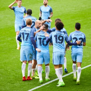 Sergo Agüero is congratulated by his team-mates after scoring for Manchester City.