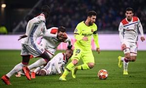 Barcelona's Lionel Messi surges past Lyon's defender Ferland Mendy (left), Lucas Tousart (second left), Marcelo (third left) and Houssem Aouar.