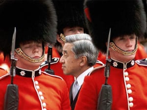 Emperor Akihito walks between ranks of soldiers as he inspects a guard of honour at the start of a five-day state visit to Britain in May 1998