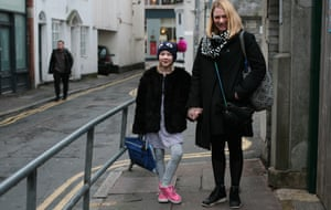 Tamsin Allistone with her daughter outside Middle Street primary school, Brighton.
