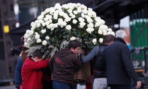 White roses are carried to La Madeleine church