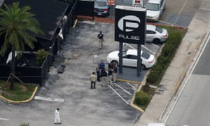 Investigators work at the scene of a mass shooting at the Pulse gay nightclub in Orlando, Florida.