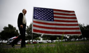 A man arrives at a polling station in Lark community center as the early voting for midterm elections started in Texas.