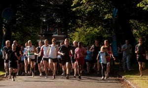 Runners take part in a 5km parkrun in Hyde park in Leeds.