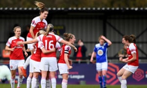 Arsenal celebrate their first goal with scorer Katie McCabe.