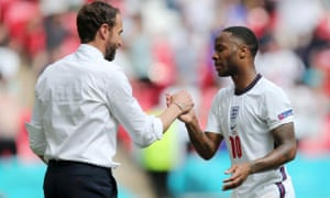Raheem Sterling of England is congratulated by Gareth Southgate after a fine afternoon's work at Wembley.