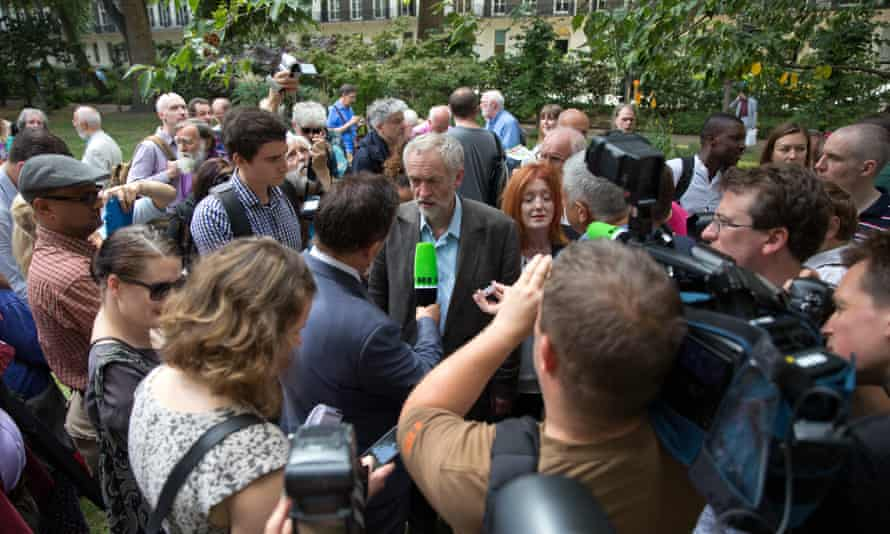 Corbyn surrounded by the media at a ceremony marking the 70th anniversary of the bombing of Hiroshima.