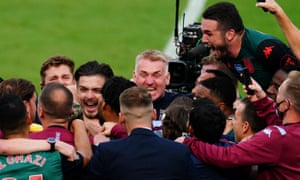 Dean Smith is at the centre of Aston Villa celebrations after a 1-1 draw at West Ham secured their Premier League place for next season.
