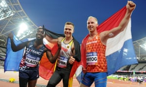 Alaize celebrates after winning bronze in the men's long jump at the IPC World ParaAthletics Championships 2017, with gold medalist Markus Rehm of Germany and silver medalist Ronald Hertog of the Netherlands.