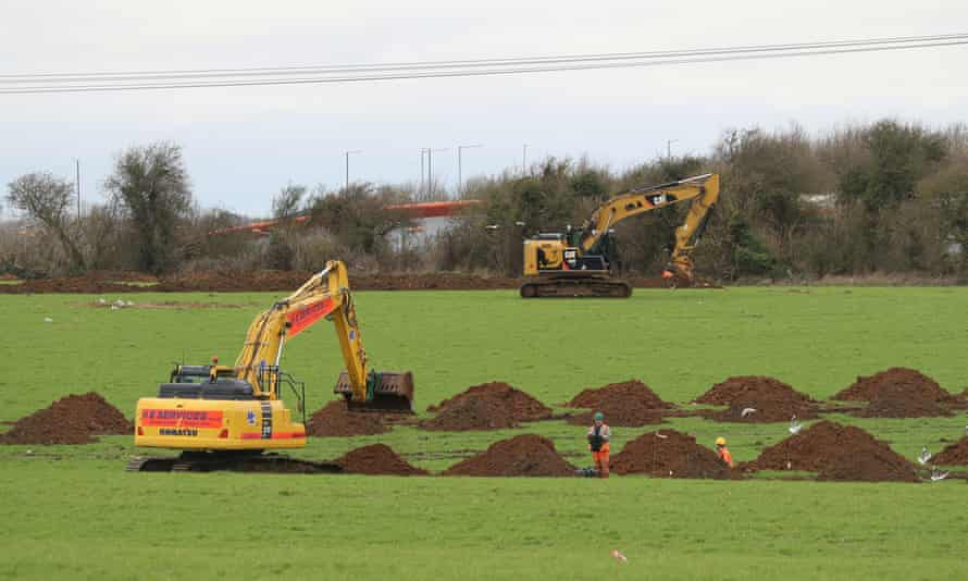 Diggers start work in fields in the village of Guston near Dover, Kent, where the Department of Transport has purchased the White Cliffs site with plans to turn it into an Inland Border Facility and lorry park for 1,200 trucks.