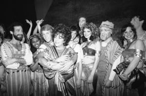 Bill Hutton, one of the Broadway musical''s stars, hugs Elizabeth Taylor in New York after she visited the cast of the show in 1982