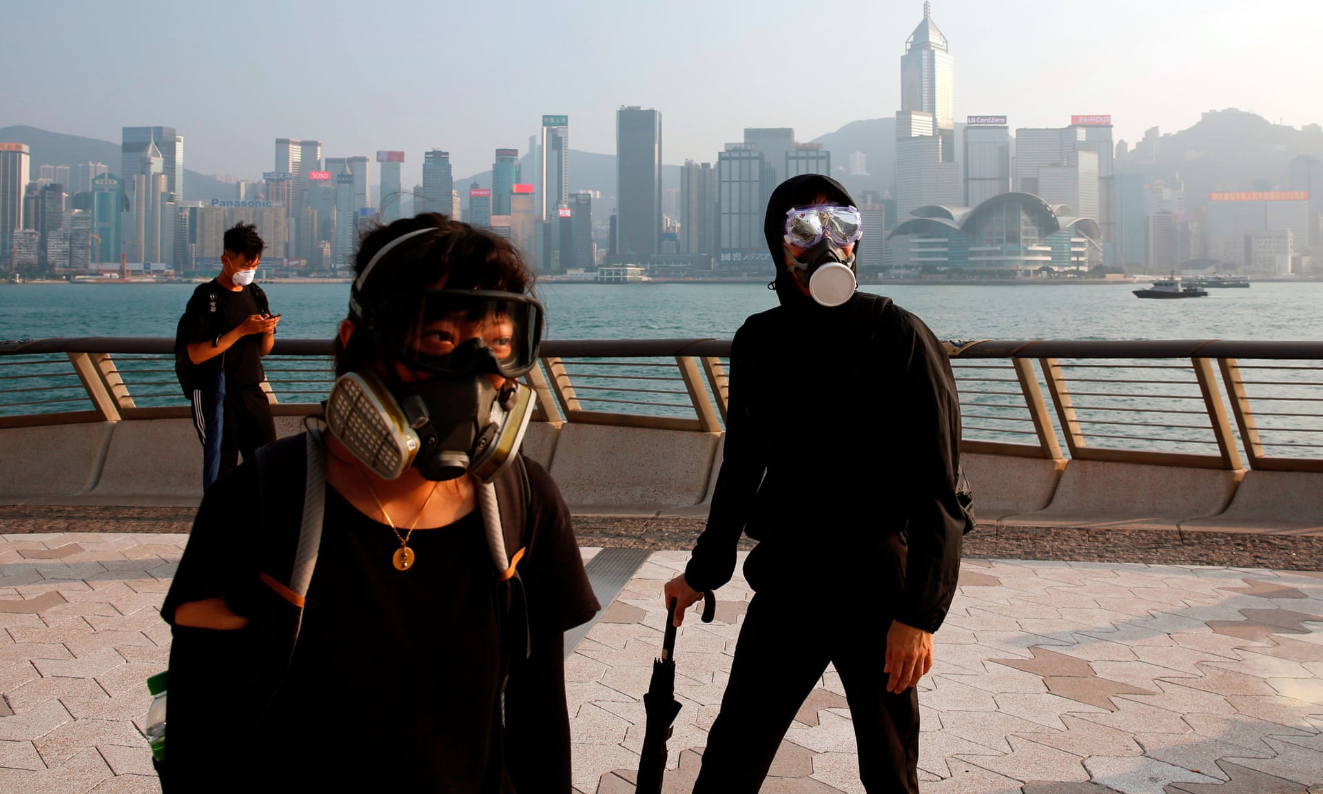 'Vast numbers still turn out for unauthorised protests, wearing masks to taunt the administration and underscore its impotence.' Photograph: Tyrone Siu/Reuters