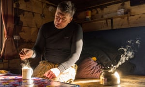 Pavel Fomenko makes himself a cup of tea in his cabin