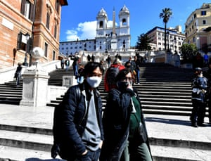 Tourists wearing protective masks visit Piazza di Spagna in Rome