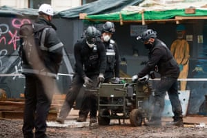 Enforcement agents work at the makeshift camp