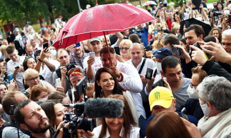 People surround presidential candidate Svetlana Tikhanovskaya as she arrives to cast her vote at a polling station during the presidential election in Minsk on Sunday.