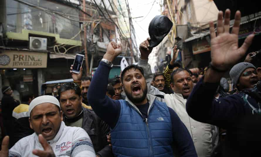 Protesters shout and march through a lane near the historic Red Fort in Delhi, India.
