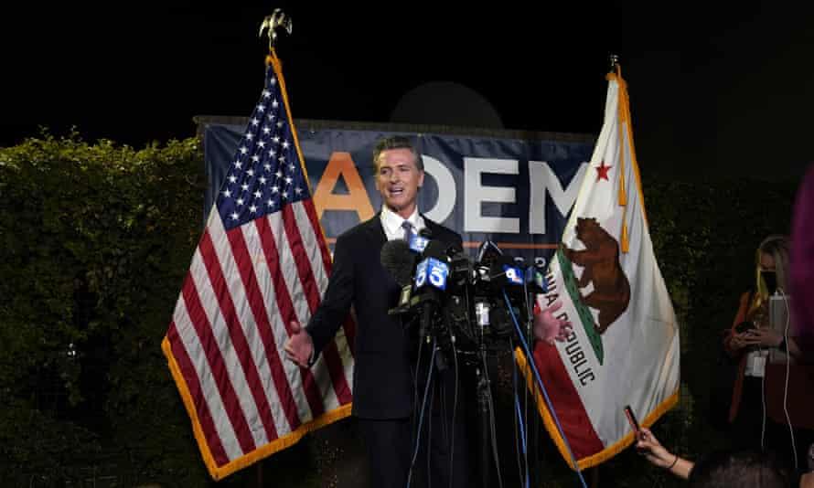 Gavin Newsom addresses reporters in Sacramento, California, on 14 September.